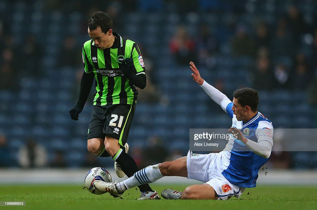 Jason Lowe of Blackburn Rovers tackles David Lopez of Brighton & Hove Albion during the npower Championship match between Blackburn Rovers and Brighton & Hove Albion at Ewood park on January 22, 2013 in Blackburn, England.