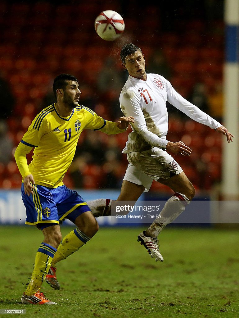 Jason Lowe of England (R) in action with Mikael Ishak of Sweden during the International Match between England Under 21's and Sweden Under 21's at Banks' Stadium on February 5, 2013 in Walsall, England.