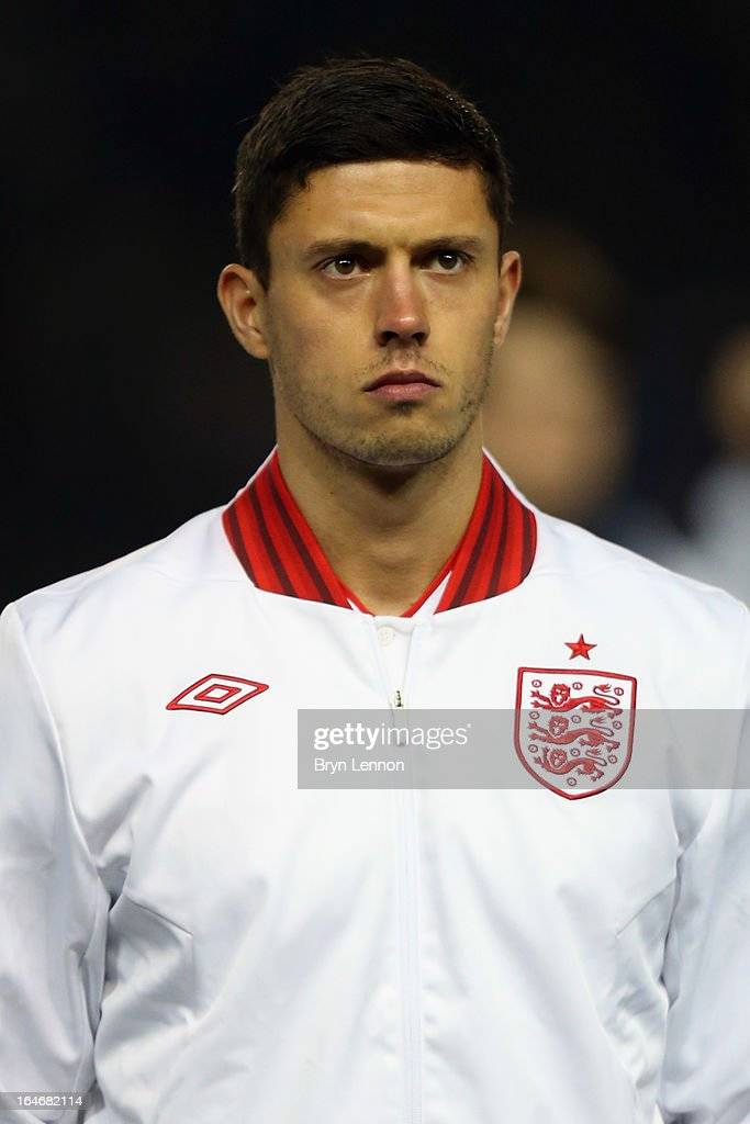 Jason Lowe of England stands for the national athems ahead during the International Friendly match between England U21 and Austria U21 at Amex Stadium on March 25, 2013 in Brighton, England.