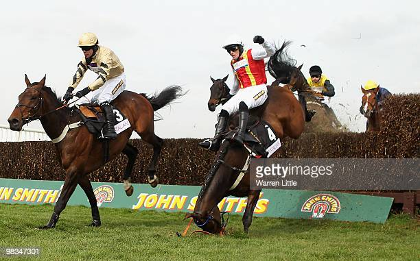 Jason Maguire takes a fall ridding Khachaturian in The matalancouk Mildmay Novices' Steeple Chase at Aintree racecourse on April 9 2010 in Liverpool...