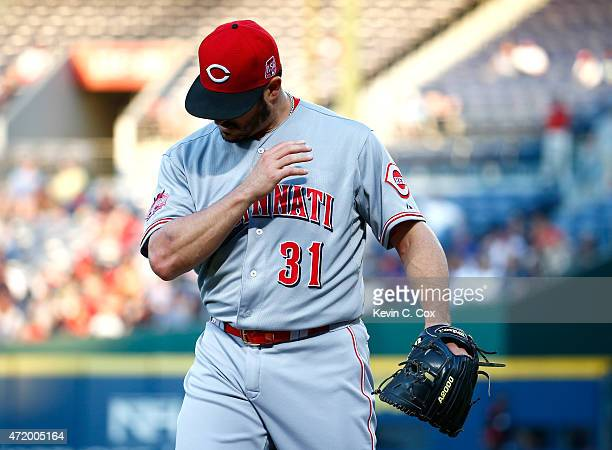 Jason Marquis of the Cincinnati Reds looks at his arm at the end of the second inning after taking a line drive off it from Kelly Johnson of the...