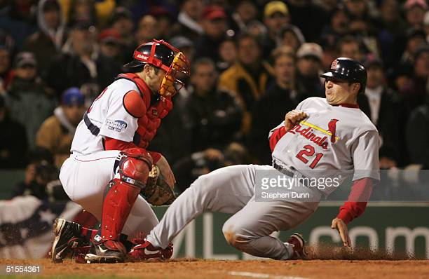 Jason Marquis the St Louis Cardinals scores on a groundball single by Edgar Renteria against Doug Mirabelli of the Boston Red Sox during the eighth...