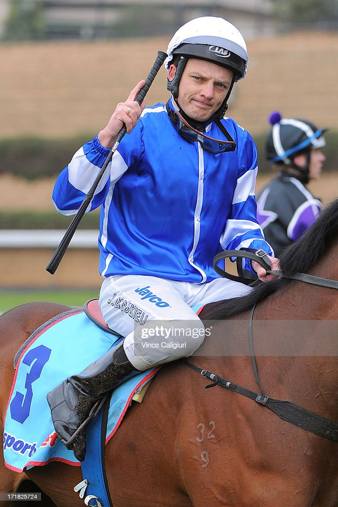Jason Maskiell riding Impulse Buy after winning the Aquanas Foods Handicap during Melbourne Racing at Moonee Valley Racecourse on June 29, 2013 in Melbourne, Australia.