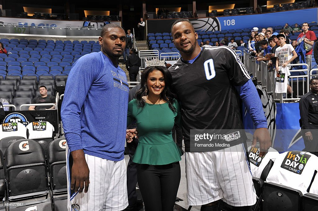 <a gi-track='captionPersonalityLinkClicked' href=/galleries/search?phrase=Jason+Maxiell&family=editorial&specificpeople=651723 ng-click='$event.stopPropagation()'>Jason Maxiell</a> #54 and Glen Davis #11 of the Orlando Magic pose with a fan before the game against the Charlotte Bobcats on January 19, 2014 at Amway Center in Orlando, Florida.