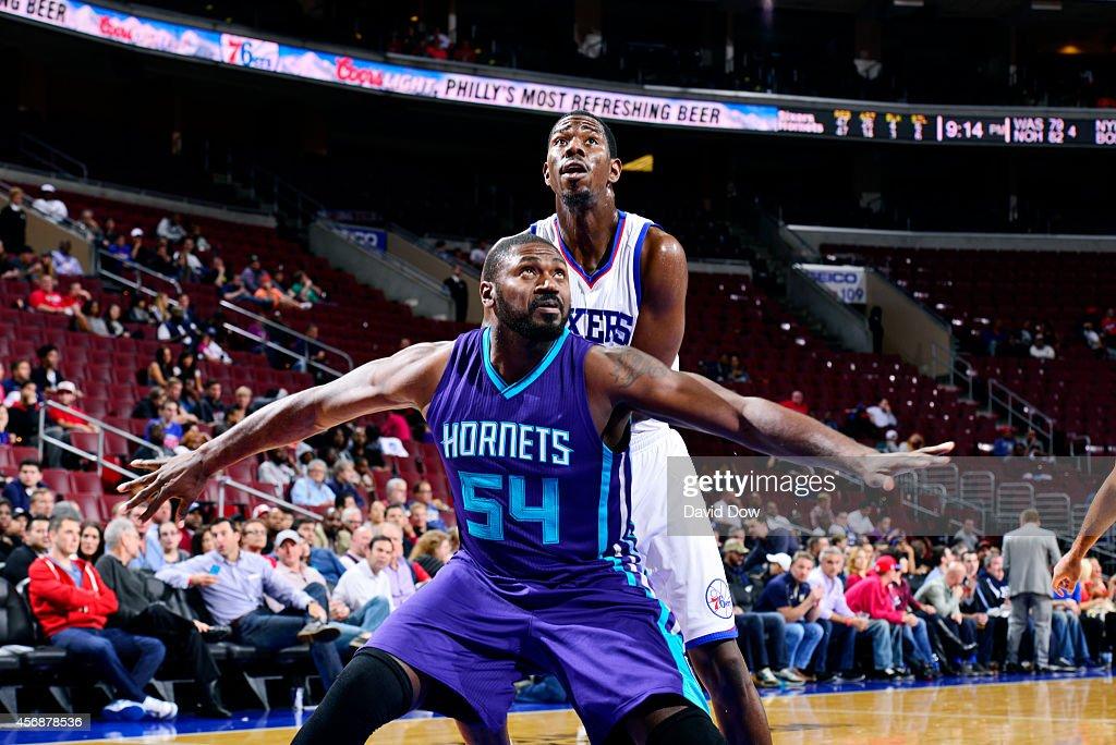 Jason Maxiell of the Charlotte Hornets battles for position against Henry Sims of the Philadelphia 76ers at the Wells Fargo Center on October 08 2014...