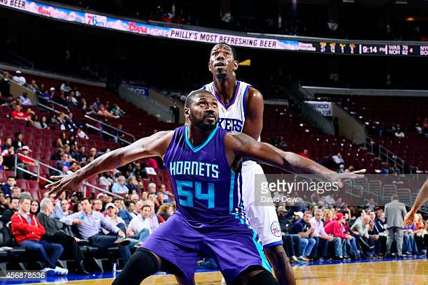 Jason Maxiell of the Charlotte Hornets battles for position against Henry Sims of the Philadelphia 76ers at the Wells Fargo Center on October 08 2014...