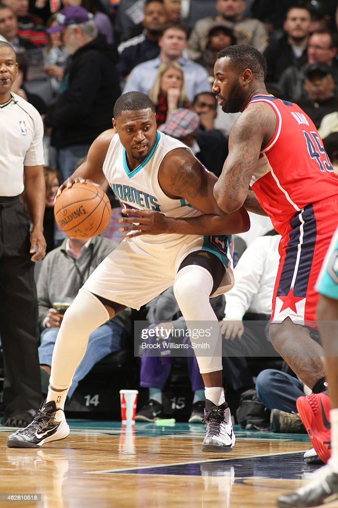 Jason Maxiell of the Charlotte Hornets defends the ball against the Washington Wizards during the game at the Time Warner Cable Arena on February 5...