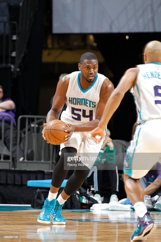 Jason Maxiell of the Charlotte Hornets handles the ball against the Boston Celtics on March 30 2015 at Time Warner Cable Arena in Charlotte North...