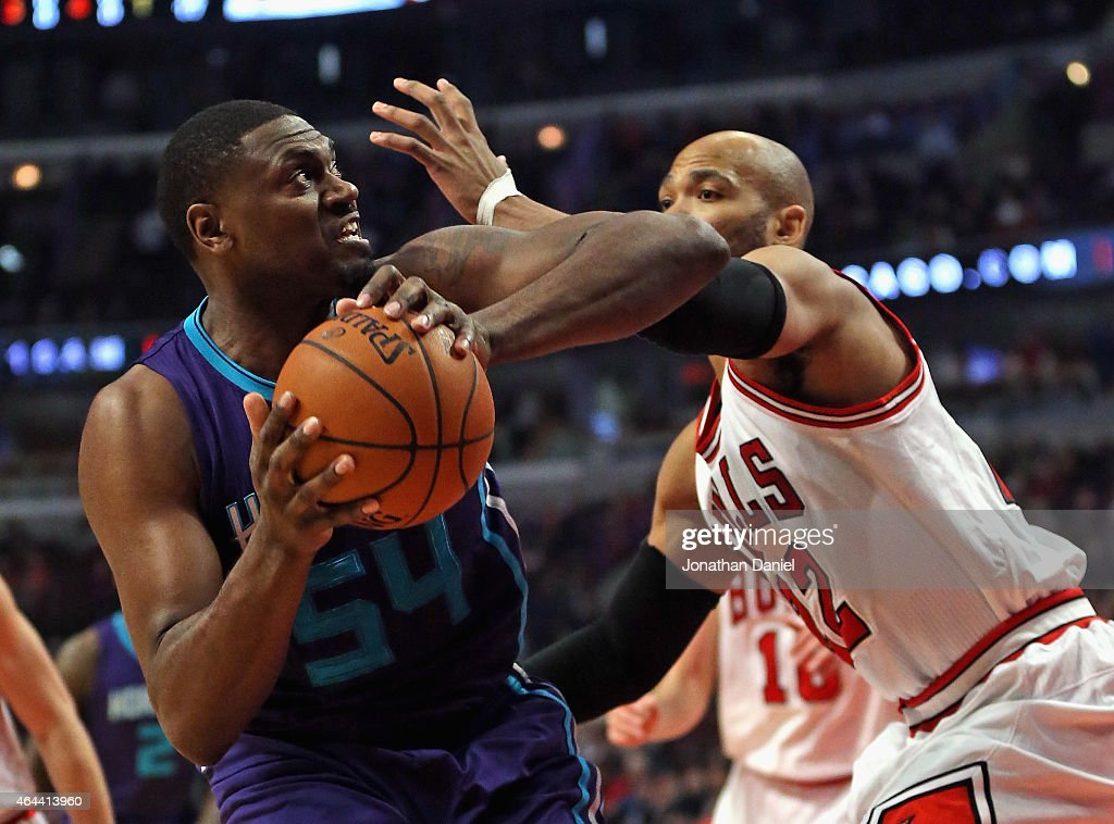 Jason Maxiell #54 of the Charlotte Hornets moves to the basket against Taj Gibson #22 of the Chicago Bulls at the United Center on February 25, 2015 in Chicago, Illinois.