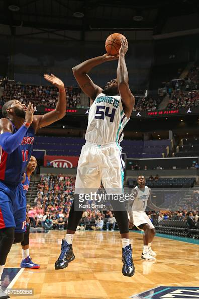 Jason Maxiell of the Charlotte Hornets shoots against Greg Monroe of the Detroit Pistons during the game at the Time Warner Cable Arena on October 15...