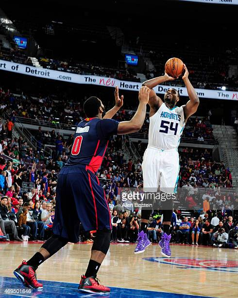 Jason Maxiell of the Charlotte Hornets shoots against the Detroit Pistons during the game on April 12 2015 at The Palace of Auburn in Detroit...