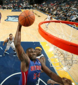Jason Maxiell of the Detroit Pistons dunks against Zach Randolph of the Memphis Grizzlies on November 24 2010 at FedExForum in Memphis Tennessee NOTE...