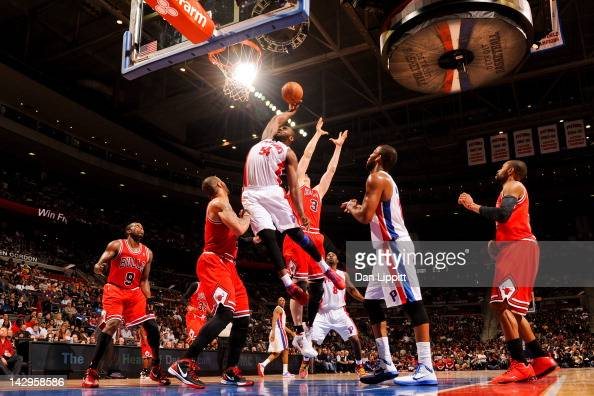 Jason Maxiell of the Detroit Pistons goes for a dunk against Omer Asik and Carlos Boozer of the Chicago Bulls on April 15 2012 at The Palace of...