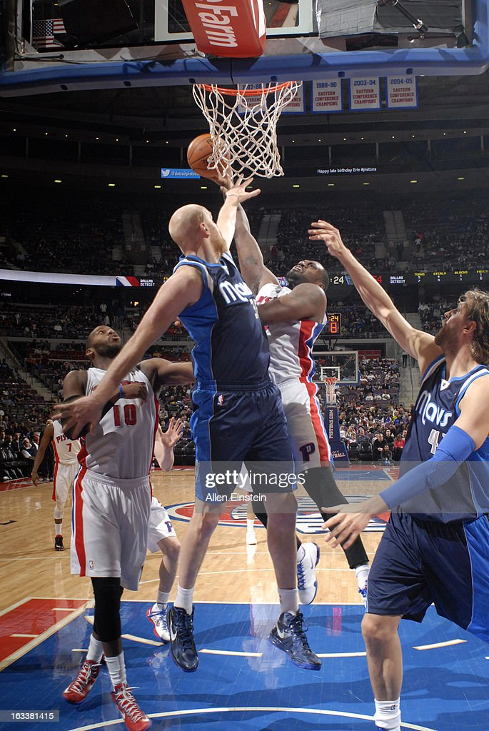 Jason Maxiell #54 of the Detroit Pistons goes to the basket against Chris Kaman #35 of the Dallas Mavericks during the game between the Detroit Pistons and the Dallas Mavericks on March 8, 2013 at The Palace of Auburn Hills in Auburn Hills, Michigan.