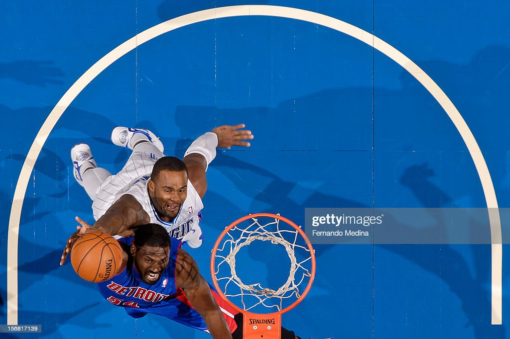 Jason Maxiell #54 of the Detroit Pistons goes to the basket against Glen Davis #11 of the Orlando Magic on November 21, 2012 at Amway Center in Orlando, Florida.