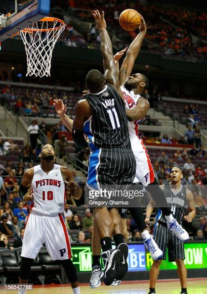 Jason Maxiell of the Detroit Pistons goes up for a dunk over Glen Davis of the Orlando Magic at the Palace of Auburn Hills on November 16 2012 in...
