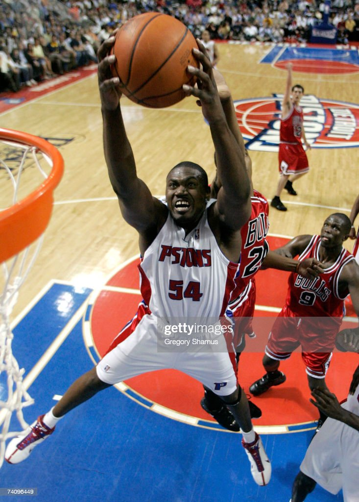 Jason Maxiell of the Detroit Pistons grabs a rebound in front of Tyrus Thomas and Luol Deng of the Chicago Bulls in Game Two of the Eastern...