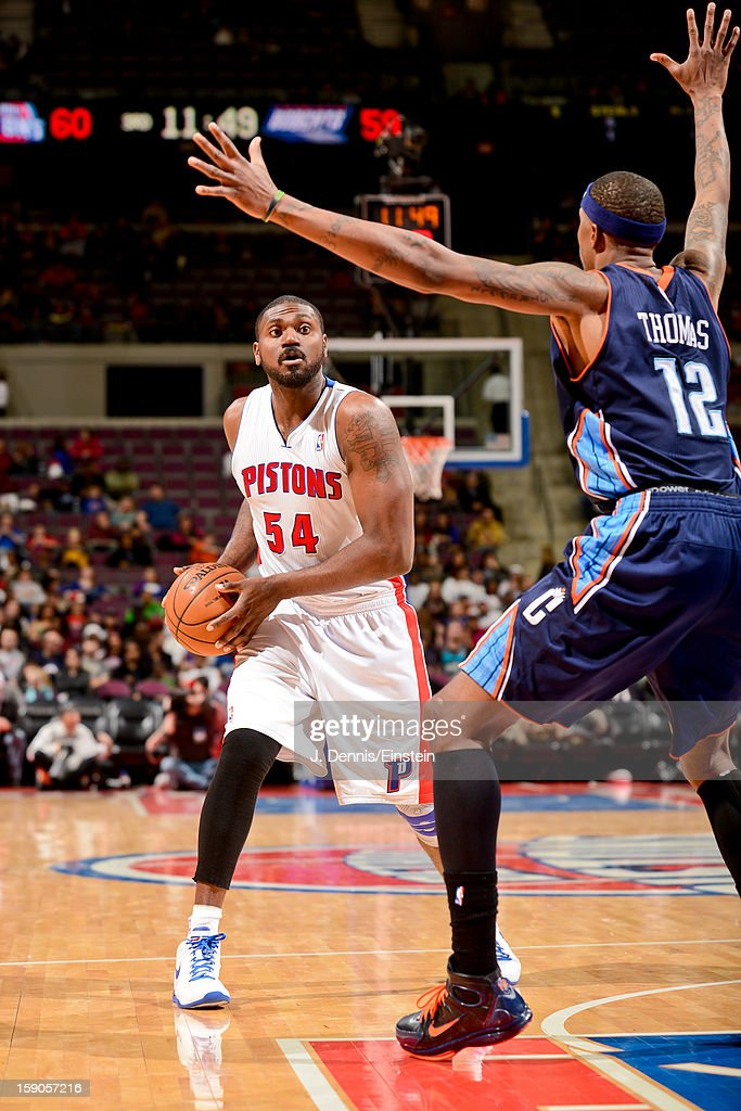 Jason Maxiell #54 of the Detroit Pistons looks to pass the ball against Tyrus Thomas #12 of the Charlotte Bobcats on January 6, 2013 at The Palace of Auburn Hills in Auburn Hills, Michigan.