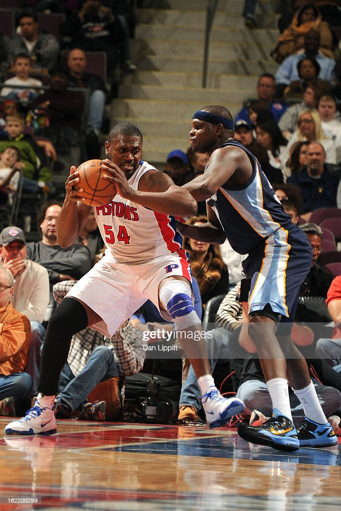Jason Maxiell #54 of the Detroit Pistons protects the ball against Zach Randolph #50 of the Memphis Grizzlies on February 19, 2013 at The Palace of Auburn Hills in Auburn Hills, Michigan.