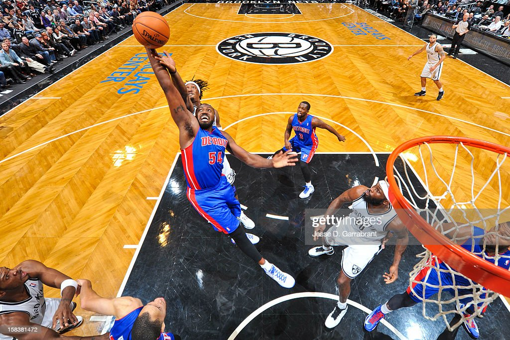 <a gi-track='captionPersonalityLinkClicked' href=/galleries/search?phrase=Jason+Maxiell&family=editorial&specificpeople=651723 ng-click='$event.stopPropagation()'>Jason Maxiell</a> #54 of the Detroit Pistons reaches for a rebound against <a gi-track='captionPersonalityLinkClicked' href=/galleries/search?phrase=Gerald+Wallace&family=editorial&specificpeople=202117 ng-click='$event.stopPropagation()'>Gerald Wallace</a> #45 of the Brooklyn Nets at the Barclays Center on December 14, 2012 in the Brooklyn borough of New York City.