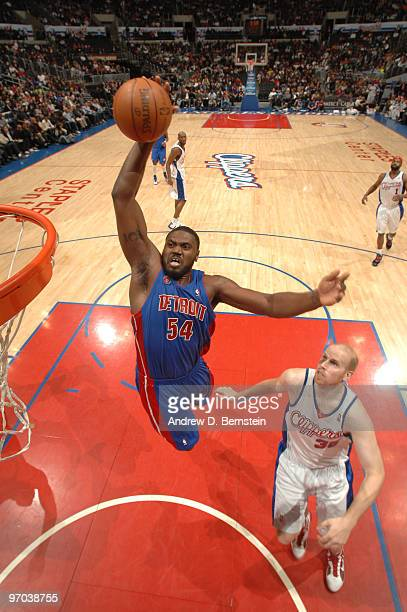 Jason Maxiell of the Detroit Pistons rises for a dunk against Chris Kaman of the Los Angeles Clippers at Staples Center on February 24 2010 in Los...