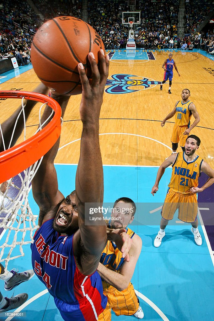 Jason Maxiell #54 of the Detroit Pistons rises for a dunk against Ryan Anderson #33 of the New Orleans Hornets on March 1, 2013 at the New Orleans Arena in New Orleans, Louisiana.