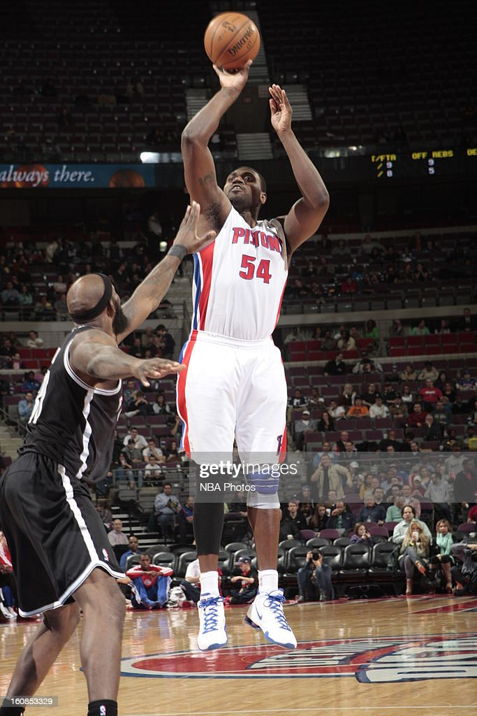 Jason Maxiell #54 of the Detroit Pistons shoots a jumper against Reggie Evans #30 of the Brooklyn Nets on February 6, 2013 at The Palace of Auburn Hills in Auburn Hills, Michigan.
