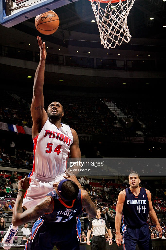 Jason Maxiell #54 of the Detroit Pistons shoots a layup against Tyrus Thomas #12 of the Charlotte Bobcats on January 6, 2013 at The Palace of Auburn Hills in Auburn Hills, Michigan.