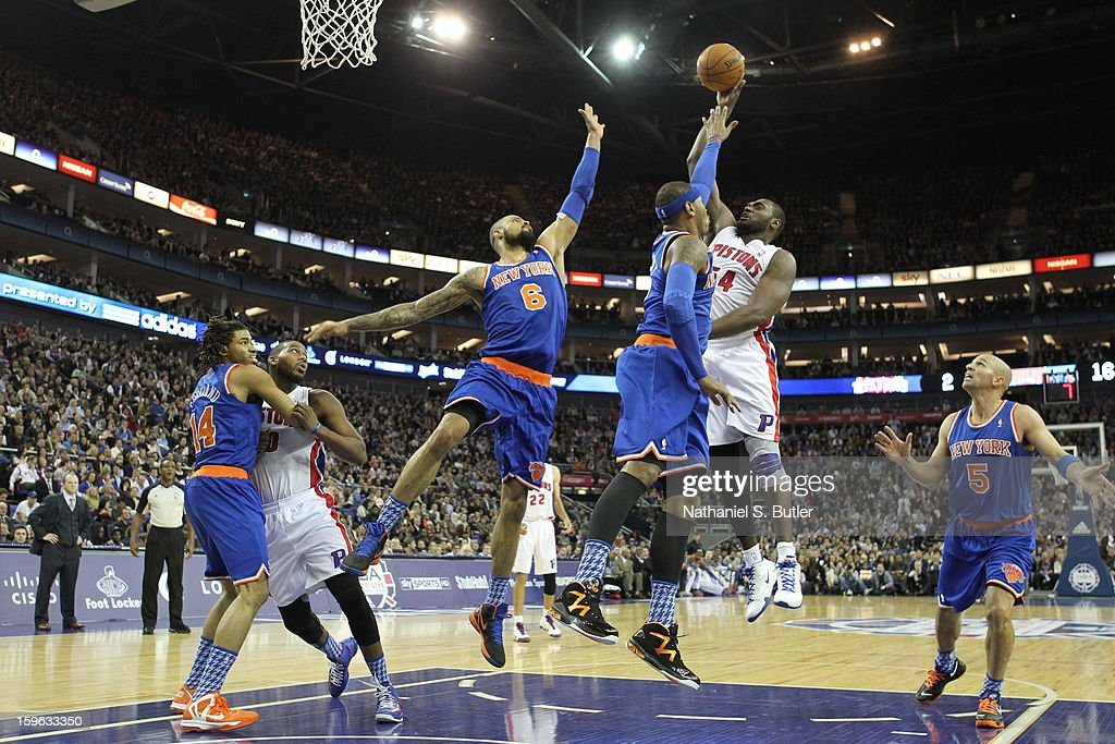 Jason Maxiell #54 of the Detroit Pistons shoots against Carmelo Anthony #7 of the New York Knicks and Tyson Chandler #6 of the New York Knicks during a game between the New York Knicks and the Detroit Pistons at the 02 Arena on January 17, 2013 in London, England.