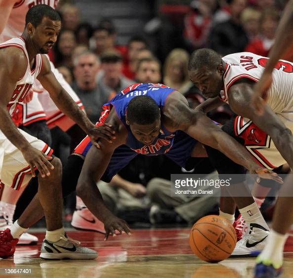 Jason Maxiell of the Detroit Pistons tries to recover a loose ball between John Lucas III and Loul Deng of the Chicago Bulls at the United Center on...