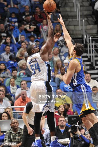 Jason Maxiell of the Orlando Magic attempts a shot during a game against the Golden State Warriors on December 31 2013 at Amway Center in Orlando...