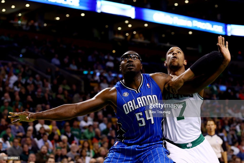 Jason Maxiell of the Orlando Magic boxes out Jared Sullinger of the Boston Celtics during a game at the TD Garden on November 11 2013 in Boston...