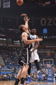Jason Maxiell of the Orlando Magic shoots against Brook Lopez of the Brooklyn Nets on November 3 2013 at Amway Center in Orlando Florida NOTE TO USER...