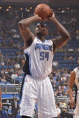 Jason Maxiell of the Orlando Magic shoots the ball against the Dallas Mavericks during the game on November 16 2013 at Amway Center in Orlando...