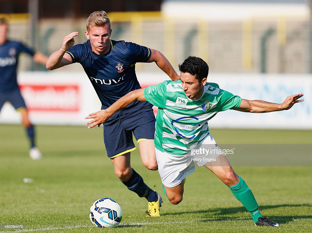 Jason McCarthy of Southampton (L) battles for the ball with Mohamed El Idrissi of KSK Hasselt during the pre-season friendly match between KSK Hasselt and Southampton at the Stedelijk Sportstadion on July 17, 2014 in Hasselt, Belgium.