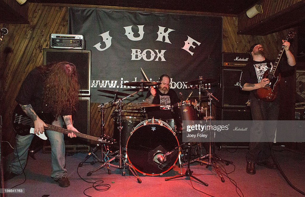 Jason McCash, 'Iron' Bob Fouts, and Karl Simon of The Gates Of Slumber performs at Indy's Jukebox on January 11, 2013 in Indianapolis, Indiana.