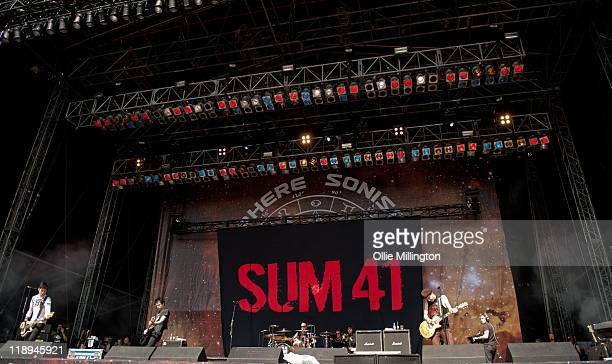 Jason McCaslin Deryck Whibley Steve Jocz and Tom Thacker of Sum 41 perform onstage at Sonisphere Festival at Knebworth House on July 9 2011 in...
