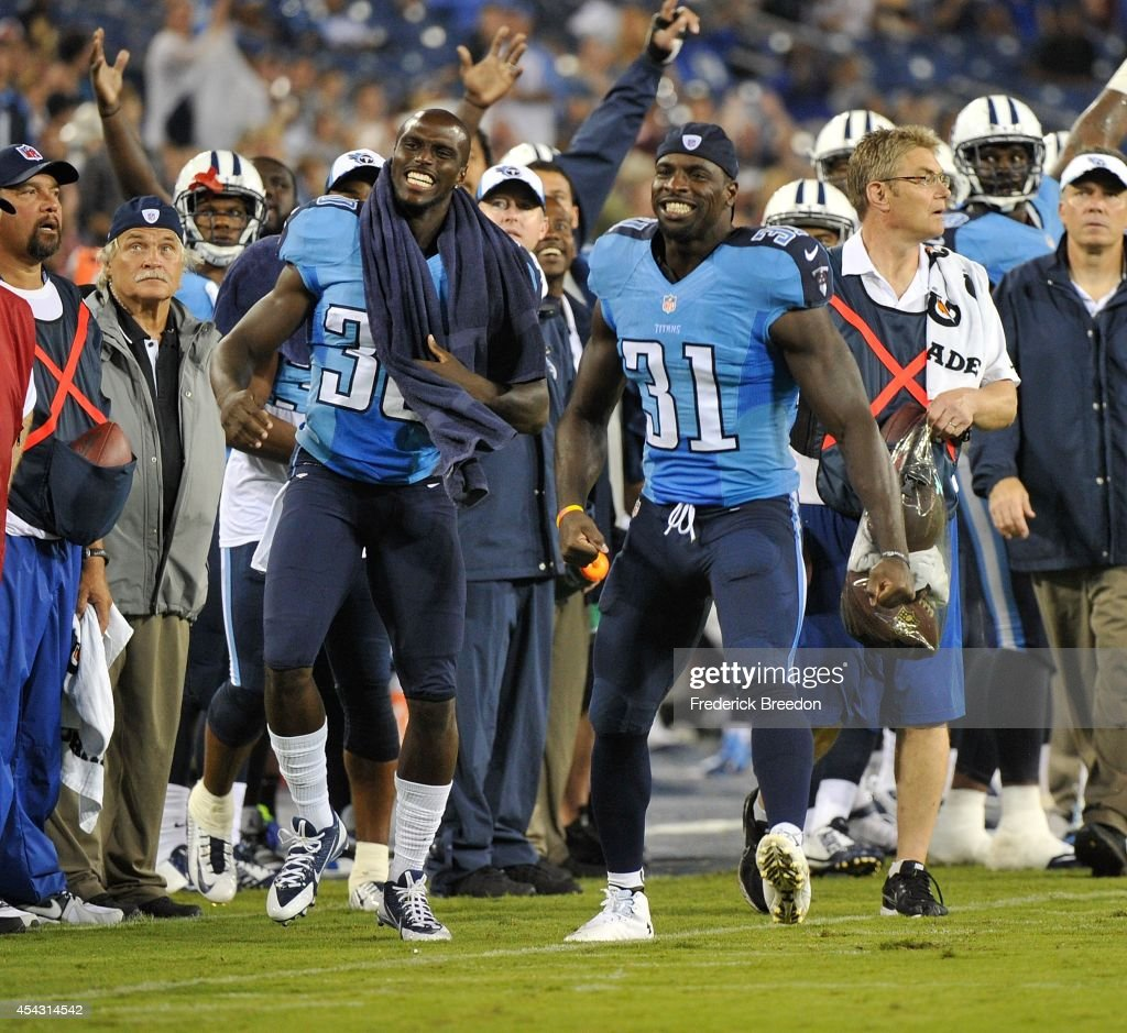 Jason McCourty #30 and Bernard Pollard #31 of the Tennessee Titans cheer for a teammate after nearly intercepting a pass by the Minnesota Vikings at LP Field on August 28, 2014 in Nashville, Tennessee.