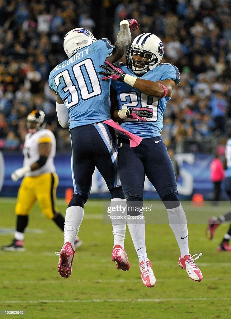 Jason McCourty #30 of the Tennessee Titans is congratulated by teammate Ryan Mouton #29 after making an interception against the Pittsburgh Steelers at LP Field on October 11, 2012 in Nashville, Tennessee.
