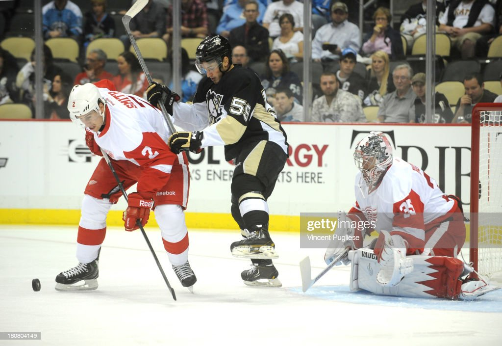 Jason Megna # 59 of the Pittsburgh Penguins battles with Brendan Smith # 2 of the Detroit Red Wings in front of Red Wings goalie <a gi-track='captionPersonalityLinkClicked' href=/galleries/search?phrase=Jimmy+Howard&family=editorial&specificpeople=2118637 ng-click='$event.stopPropagation()'>Jimmy Howard</a> # 35 in the first period of a preseason game on September 16, 2013 at the CONSOL Energy Center in Pittsburgh, Pennsylvania.