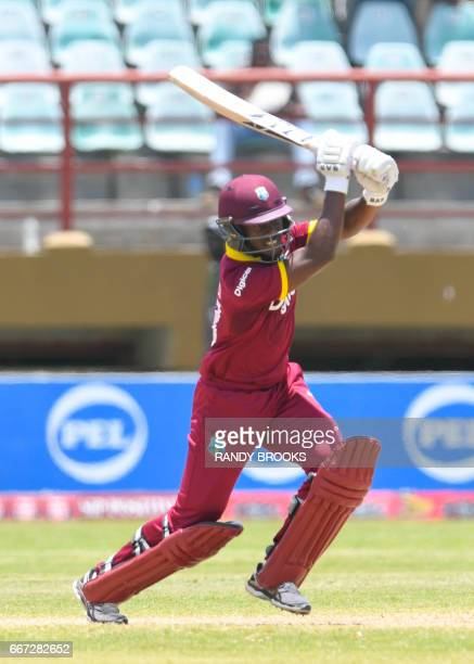 Jason Mohammed of the West Indies hits 4 during the 3rd and final ODI match between West Indies and Pakistan at Guyana National Stadium Providence...