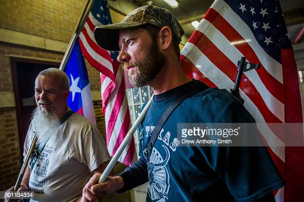 Jason Moseley and Phil Neumann along with other progun activists march close to The University of Texas campus December 12 2015 in Austin Texas In...