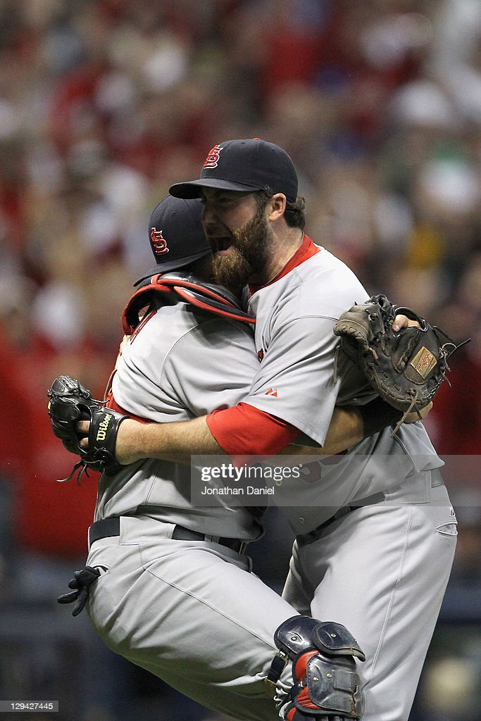 Jason Motte and Yadier Molina of the St Louis Cardinals celebrate after they won 126 against the Milwaukee Brewers during Game Six of the National...