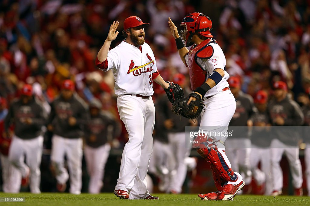 Jason Motte and catcher Yadier Molina of the St Louis Cardinals celebrate the Cardinals 31 victory against the San Francisco Giants in Game Three of...