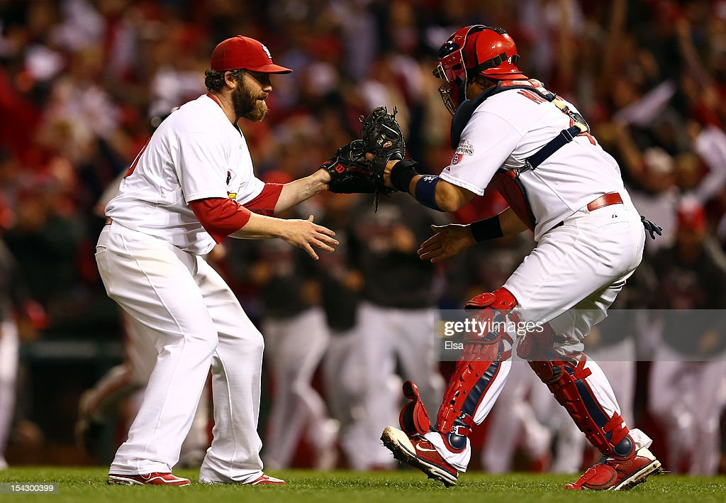 <a gi-track='captionPersonalityLinkClicked' href=/galleries/search?phrase=Jason+Motte&family=editorial&specificpeople=803364 ng-click='$event.stopPropagation()'>Jason Motte</a> #30 and catcher <a gi-track='captionPersonalityLinkClicked' href=/galleries/search?phrase=Yadier+Molina&family=editorial&specificpeople=172002 ng-click='$event.stopPropagation()'>Yadier Molina</a> #4 of the St. Louis Cardinals celebrate the Cardinals 3-1 victory against the San Francisco Giants in Game Three of the National League Championship Series at Busch Stadium on October 17, 2012 in St Louis, Missouri.