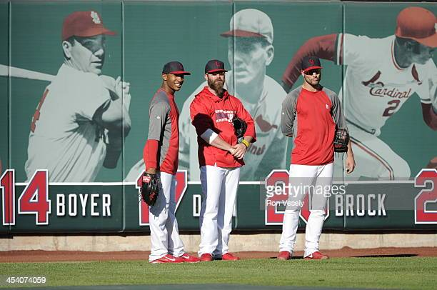 Jason Motte and other members of the bullpen of the St Louis Cardinals look on prior to Game One of the National League Championship Series against...