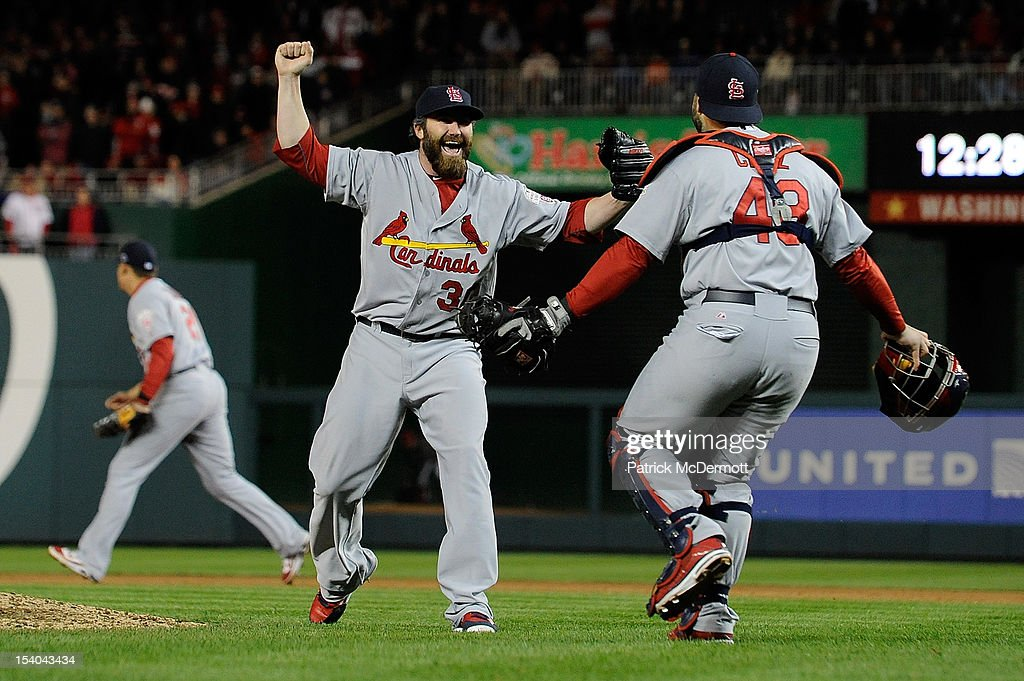 <a gi-track='captionPersonalityLinkClicked' href=/galleries/search?phrase=Jason+Motte&family=editorial&specificpeople=803364 ng-click='$event.stopPropagation()'>Jason Motte</a> #30 celebrates with Tony Cruz #48 of the St. Louis Cardinals after the Cardinals defeated the Washington Nationals 9-7 in Game Five of the National League Division Series at Nationals Park on October 12, 2012 in Washington, DC.
