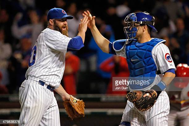 Jason Motte of the Chicago Cubs and Miguel Montero celebrate their win over the St Louis Cardinals during game two of a double header at Wrigley...