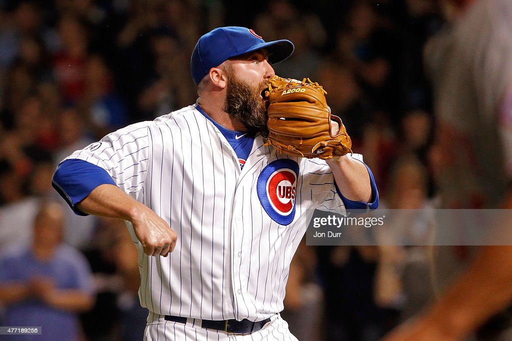 Jason Motte of the Chicago Cubs celebrates after the third out against the Cincinnati Reds during the ninth inning with the bases loaded at Wrigley...