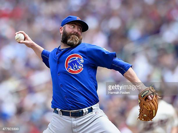 Jason Motte of the Chicago Cubs delivers a pitch against the Minnesota Twins during the ninth inning of the game on June 20 2015 at Target Field in...
